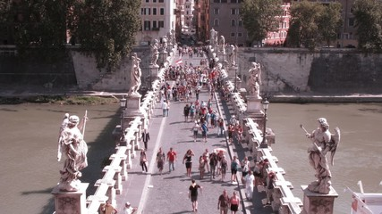 many people passing across Bridge in Rome