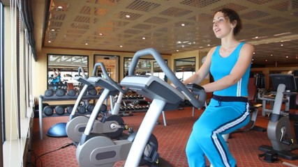 woman reverse spinning on exercise bicycle