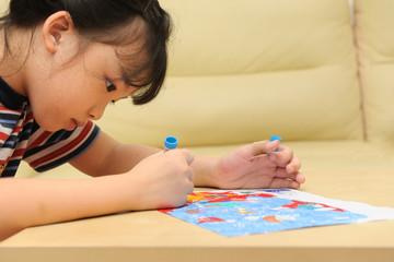 Asian kid painting