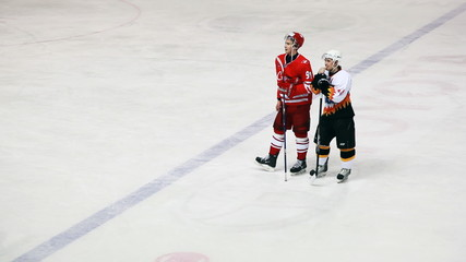 Friendly hockey players from two teams on junior hockey match