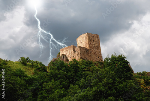 isolated tower in the forest under the lightning