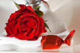 Place setting with a rose and candy