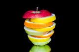 Sliced fruits isolated on black background