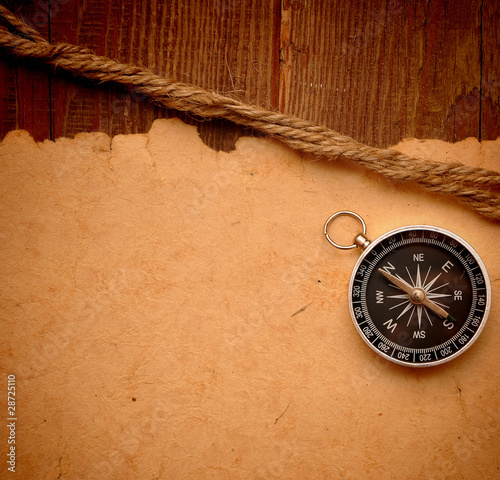 compass and rope on grunge background