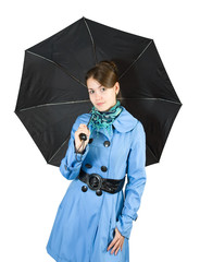woman wearing coat holding umbrella