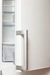 Open door of empty refrigerator