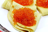 Tasty pancakes with soft caviar on the plate