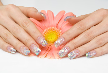 Sparkling manicure and a pink flower