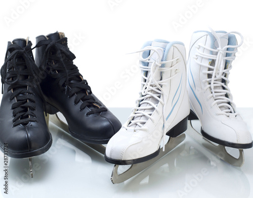 Two pairs of figure skates for ice skating
