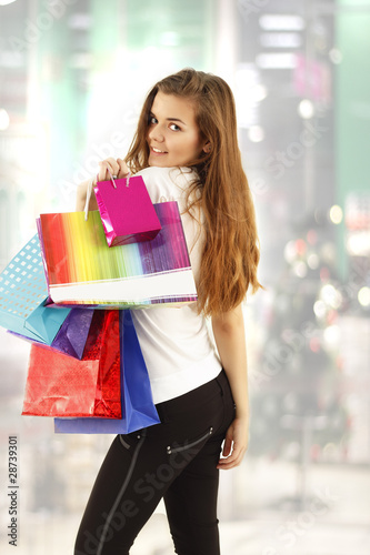 shopping teen girl smiling with bags in christmas store