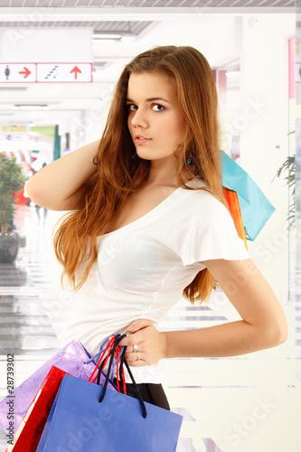 shopping teen girl smiling holding bags