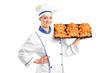 A female baker holding croissants