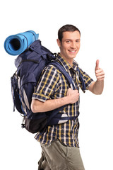 Man in sportswear with backpack giving thumb up