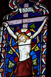Detail of stained glass religious window in church poster