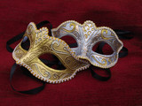 Fototapety Two masquerade mask on red cusion