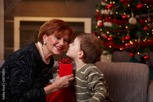Little boy getting surprise at christmas
