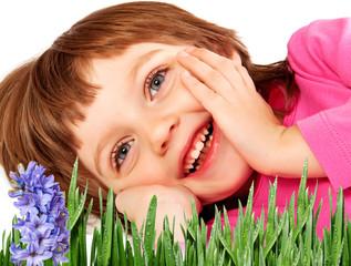 little girl resting in the spring garden