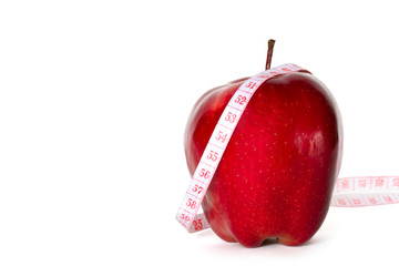 red apple with centimeter isolated on white