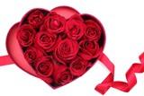 Rose petals in heart-shaped box