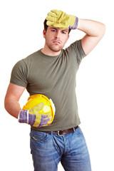Bauarbeiter wischt sich über die Stirn