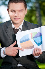 business man show graph at park. Student