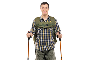Man in sportswear with backpack and hiking poles