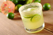 Fresh lemonade of green limes in sugar-rimmed glass