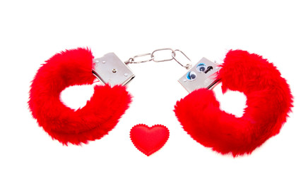 red soft sexual handcuffs with a heart isolated over white