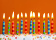 Birthday candles on orange background