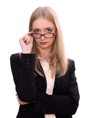 Young blonde businesswoman holding glasses