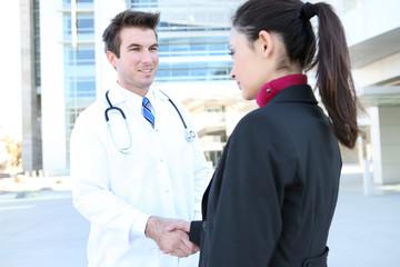 Doctor Handshake with Patient