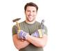 Lachender Handwerker mit Werkzeug