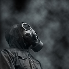 Hooded man wearing Gas mask