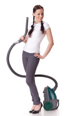 .Young woman with vacuum cleaner.