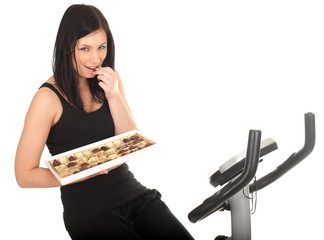 I want stay slim - training woman with chocolate box