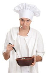 smoking male cook in white uniform with brown bowl