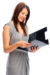 Pretty businesswoman holds a file