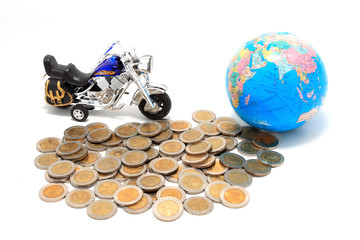 Globe and car on the pile of coins - isolated