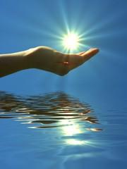 hand holding sun