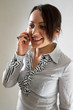 Business woman on the phone smiling