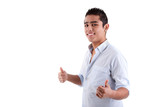 Young latin man with thumbs raised as a sign of ok