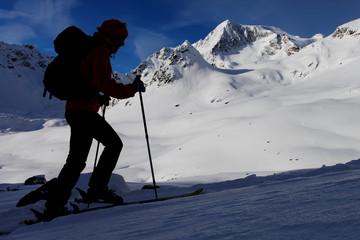 Silhouette of mountaineer. Outdoor winter activity