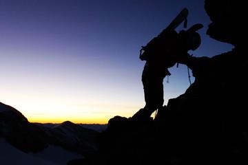 Outdoor sport - silhouette of a climber.