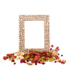 Empty picture frame with dried flowers and leaves