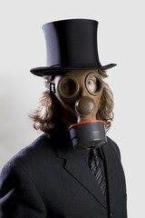 Businessman wearing a gas mask and a top hat