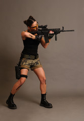 Woman with weapon.