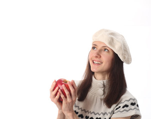Happy beautiful young woman holding red apple