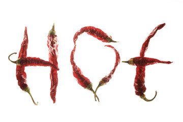 "Red chilli peppers spelling the word ""hot"""