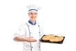 Smiling baker showing freshly baked breads