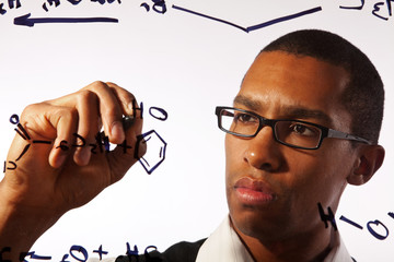 A young man works on a chemistry problem.